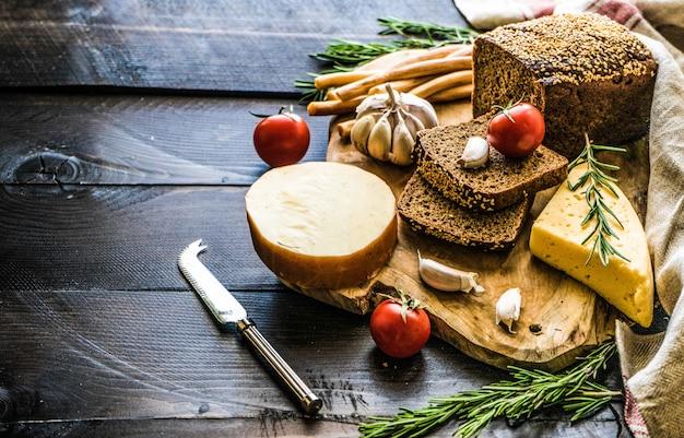 Georgian cheese on dark wooden board Premium Photo