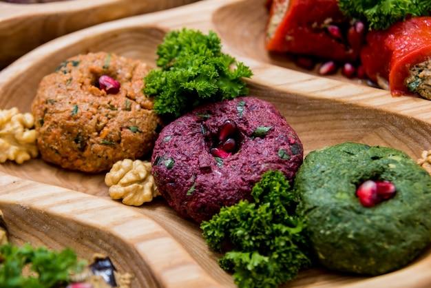 Georgian cuisine food set. khachapuri, dolma, satsivi, khinkali, pkhali. Premium Photo
