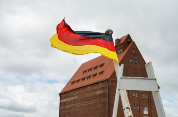 German flag flaps on the wind in stralsund, germany Premium Photo