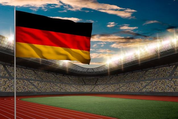 Bandiera tedesca davanti a uno stadio di atletica leggera con i fan. Foto Gratuite