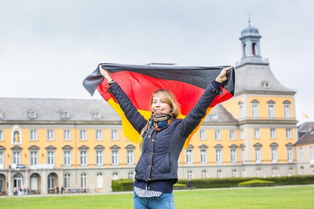 German girl with flag in front of bonn university Premium Photo
