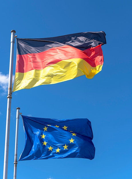 Germany and european union flags against blue sky in berlin Premium Photo