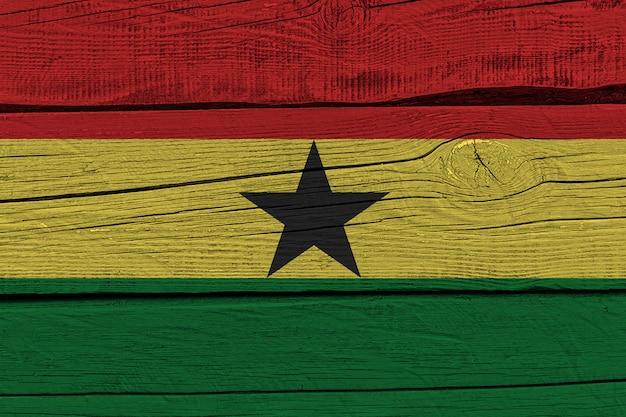 Ghana flag painted on old wood plank Premium Photo