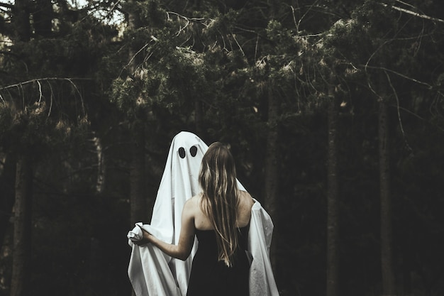 Ghost and lady hugging in park Free Photo