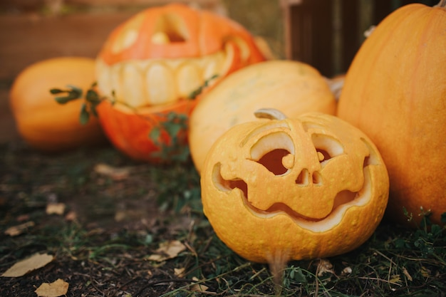 Ghost pumpkins on halloween. ead jack on an autumn . holiday outdoor decorations Premium Photo