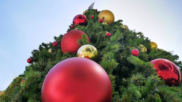giant christmas tree with red and gold decorative balls viewed from bottom premium photo - Giant Christmas Balls