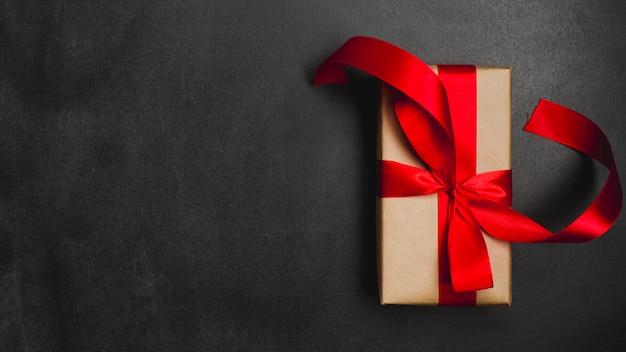Gift box on black background Free Photo