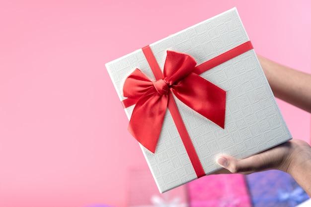 Gift box on pink background Premium Photo