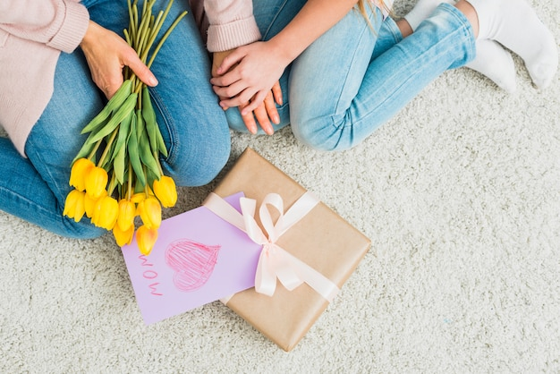 Gift box with mother`s day postcard near woman and girl Free Photo