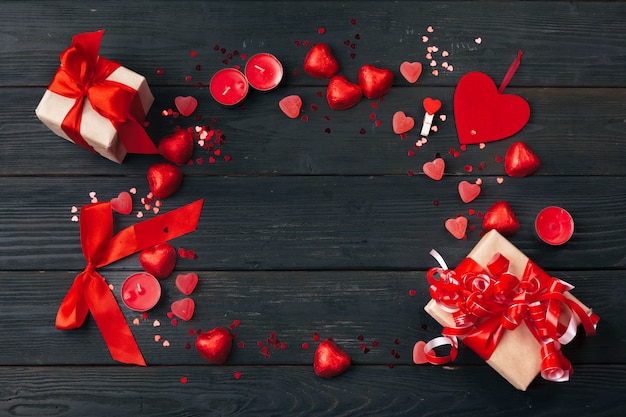 Gift box with red hearts on wooden table Premium Photo