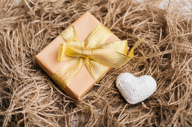 Gift box with small soft heart on table Free Photo