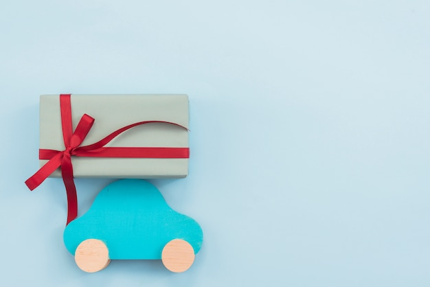 Gift box with toy car on table Free Photo