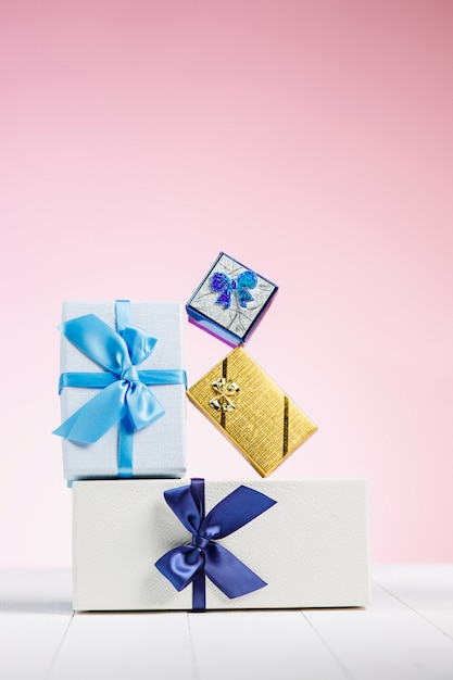 Gift box wrapped in recycled paper with ribbon bow Free Photo