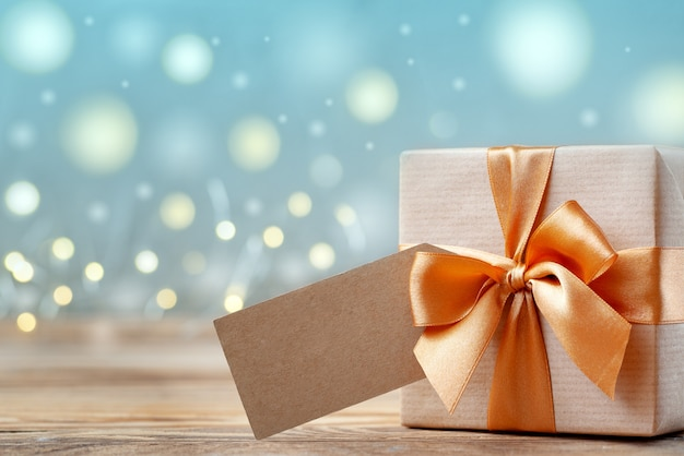 Gift box wrapped with craft paper and bow Premium Photo