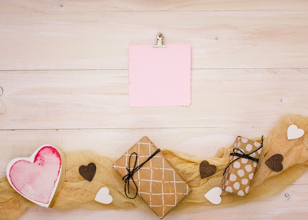 Gift boxes with blank paper and red heart Free Photo
