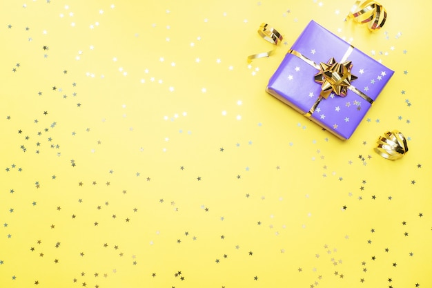 gift boxes with gold ribbons and bows confetti stars on a