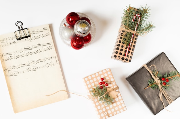 Gift boxes with music notes on table Free Photo