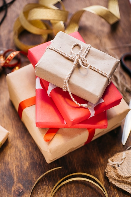 Gift boxes with ribbons on brown table Free Photo