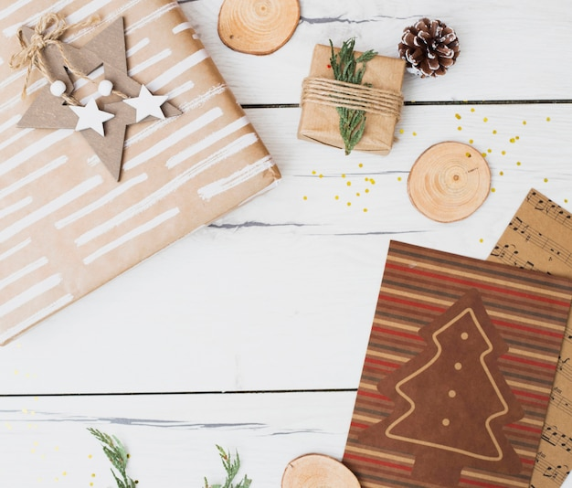 Gift boxes in wraps near christmas decorations Free Photo