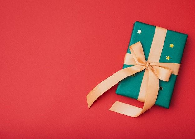 Gift with golden stars for christmas with copy space Free Photo