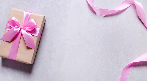 Gift with pink ribbon Free Photo