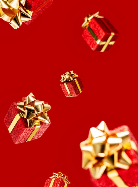Gifts are flying in the air on a red background. sale. levitation concept. christmas layout. Premium Photo