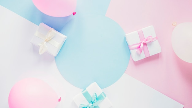 Gifts and balloons on colorful background Premium Photo