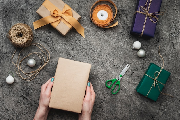 Gifts for christmas on textured background and scissors Free Photo