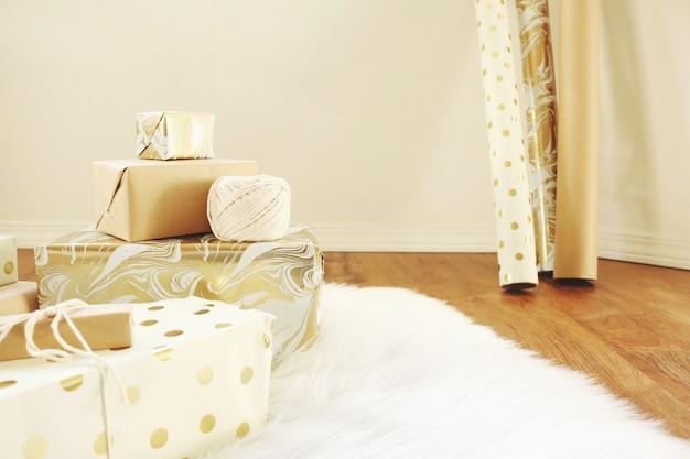 Gifts on white carpet Free Photo