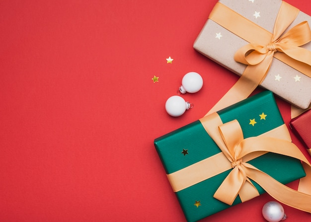Gifts with golden stars and globes for christmas Free Photo