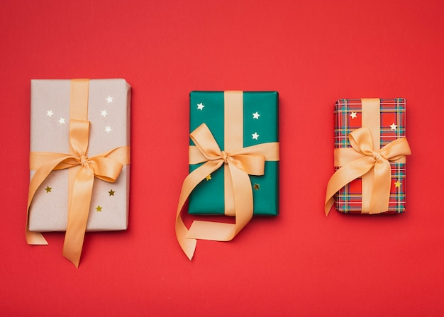 Gifts wrapped in christmas paper with golden stars Free Photo