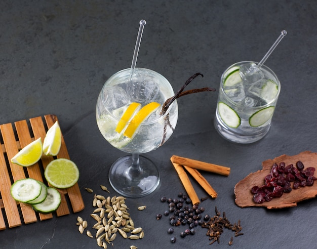 Gin tonic cocktail with lima and many spices Premium Photo