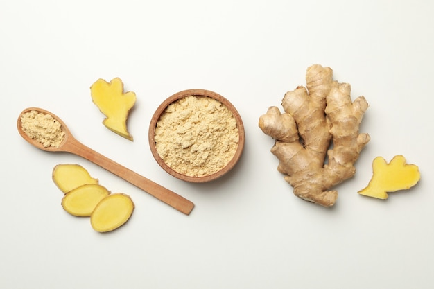 Ginger and bowl with ginger powder on white background Premium Photo