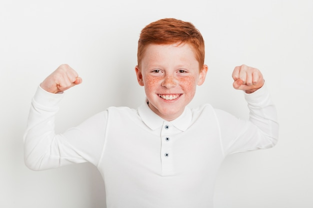 Ginger boy doing strong gesture Free Photo