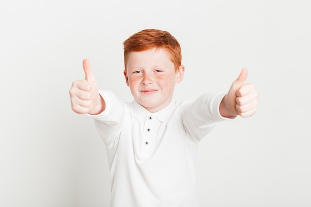 Ginger boy doing thumbs up Free Photo