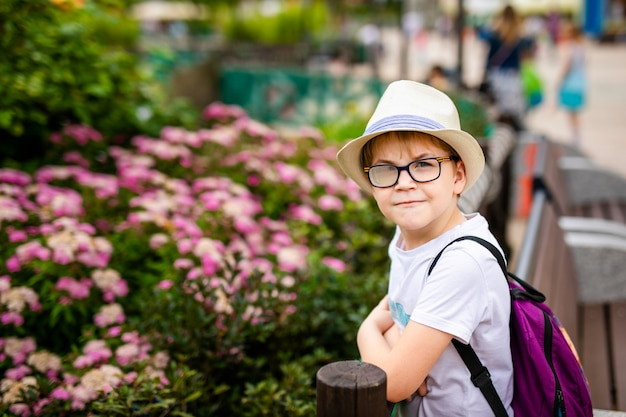 Ginger boy in the hat and big glasses in the park Premium Photo