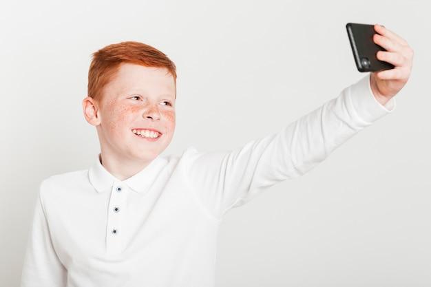 Ginger boy taking a selfie Free Photo