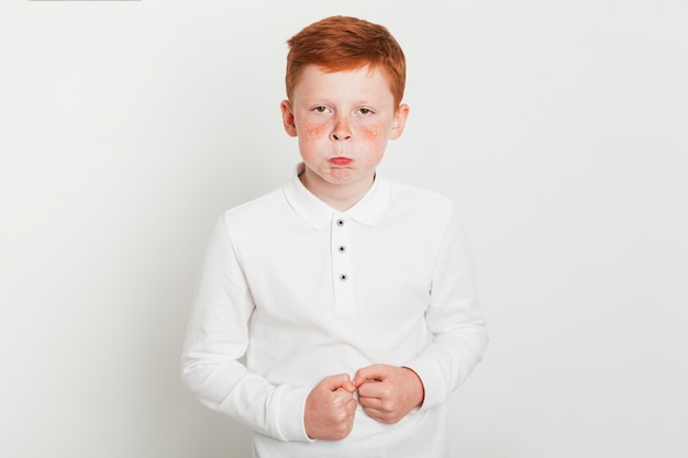 Ginger boy with angry expression Free Photo