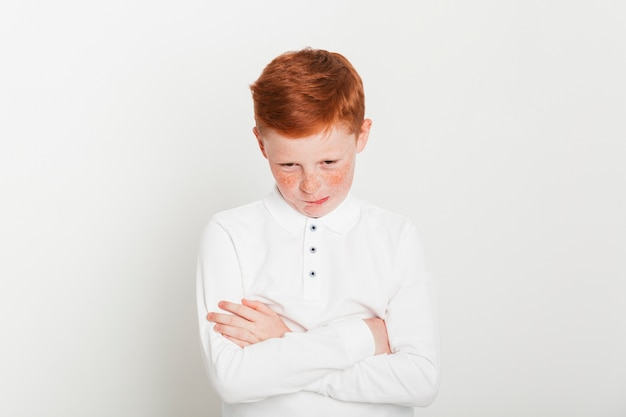 Ginger boy with arms crossed Free Photo