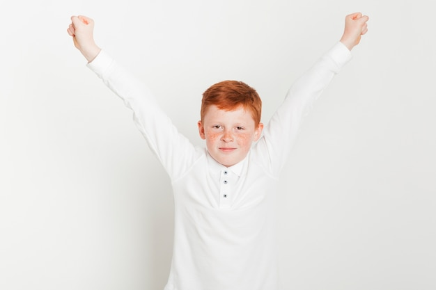Ginger boy with arms raised Free Photo