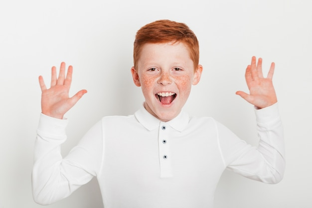 Ginger boy with cheerful expression Free Photo