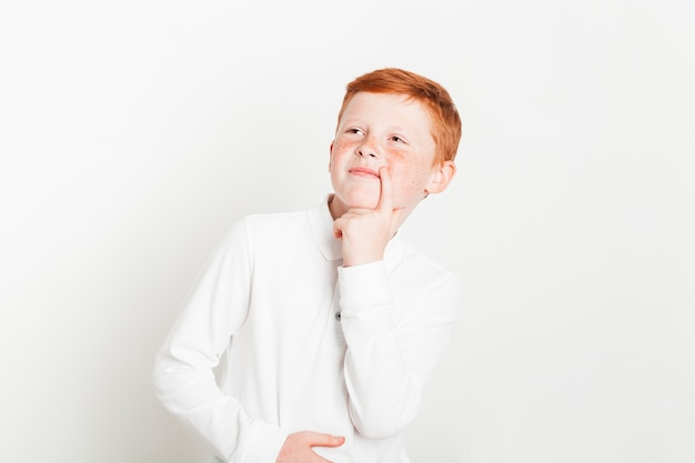 Ginger boy with thinking expression Free Photo