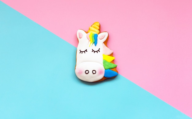 Ginger cookies in the shape of a unicorn on geometric pastel paper Premium Photo