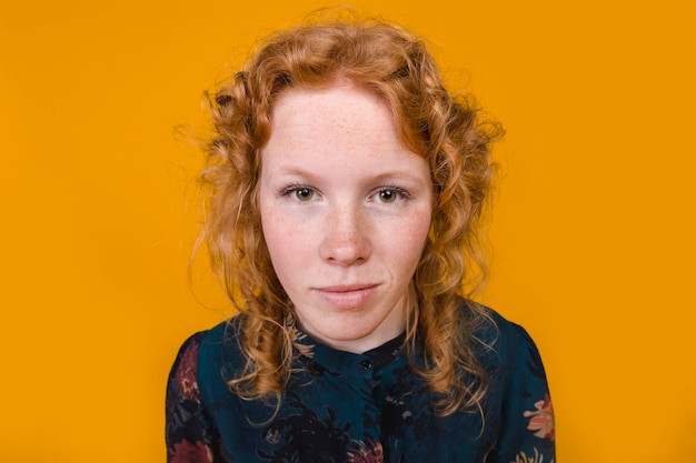 Ginger curly young woman looking at camera Free Photo