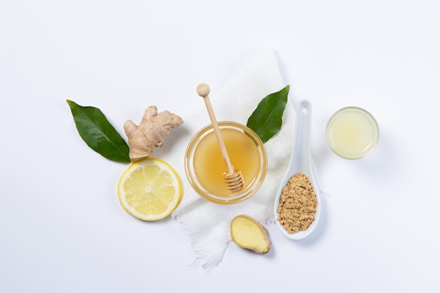 Ginger, honey and lemon,  in white plates and spoon Premium Photo