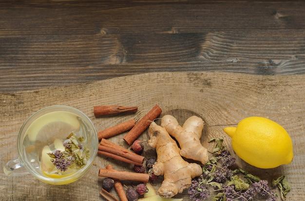 Ginger tea lemon with herbs and cinnamon Premium Photo