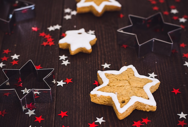 Gingerbread cookies christmas new year star with form for cutting out cookies Free Photo