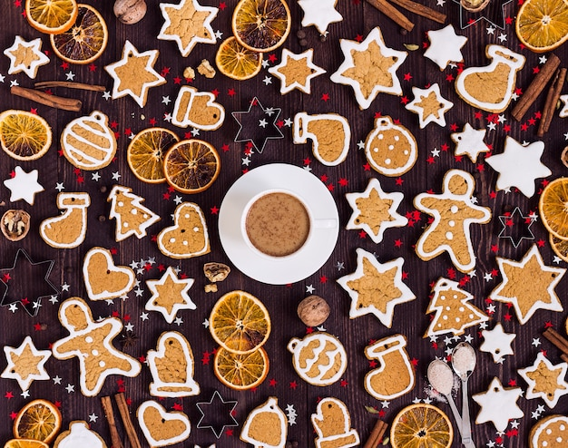 Gingerbread cookies cup of coffee christmas drink new year oranges cinnamon Free Photo