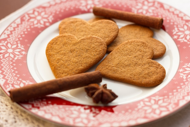 Gingerbread Heart Shaped Cookies With Cinnamon Sticks And Anise