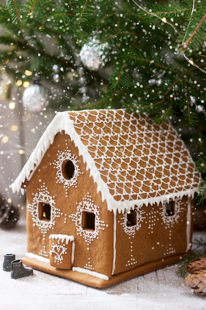 Gingerbread house and christmas trees Premium Photo
